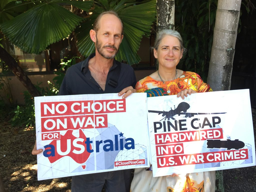 Cairns Peace Pilgrims - Paul Christie and Margaret Pestorius. Margaret is in her wedding dress - hand painted silk with symbols of peace such as doves and the peace sign